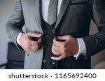 grooms morning preparation ... | Shutterstock . vector #1165692400