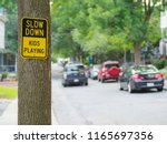 Sign \'slow Down   Kids Playing...