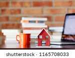 wooden house toy on a table... | Shutterstock . vector #1165708033
