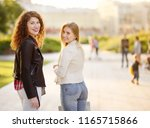 outdoors portrait of two... | Shutterstock . vector #1165715866