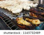 close up cooked grilled bananas ... | Shutterstock . vector #1165732489