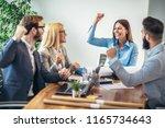 happy business people...   Shutterstock . vector #1165734643