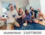 happy friends or football fans...   Shutterstock . vector #1165738330