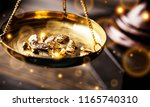 small gold nuggets in an... | Shutterstock . vector #1165740310