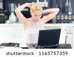 female freelancer in her casual ... | Shutterstock . vector #1165757359