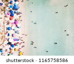 aerial view of a white beach... | Shutterstock . vector #1165758586