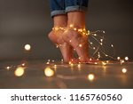 the steps of a young girl are... | Shutterstock . vector #1165760560