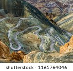 top view of a serpentine road... | Shutterstock . vector #1165764046