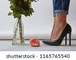 beautiful female legs in black... | Shutterstock . vector #1165765540