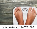 female legs on scales on... | Shutterstock . vector #1165781683