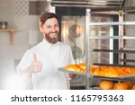 a young handsome baker shows... | Shutterstock . vector #1165795363