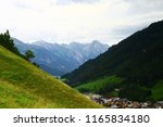 a view of the alpine town in... | Shutterstock . vector #1165834180
