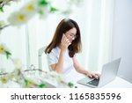 young asian girl is freelancer... | Shutterstock . vector #1165835596
