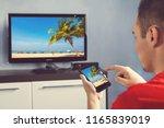 mature man with smartphone... | Shutterstock . vector #1165839019
