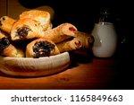 sweet baking in a wooden plate... | Shutterstock . vector #1165849663