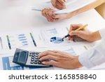 businesswoman holding a pen... | Shutterstock . vector #1165858840
