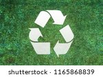 recycle sign grass background | Shutterstock . vector #1165868839