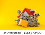 house with chain and padlock... | Shutterstock . vector #1165872400