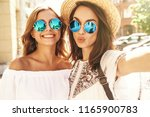 two young female smiling hippie ... | Shutterstock . vector #1165900783