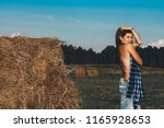 hot girl in autumn field. young ... | Shutterstock . vector #1165928653