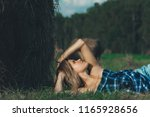 hot girl in autumn field. young ... | Shutterstock . vector #1165928656