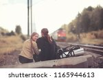traveling with a backpack on... | Shutterstock . vector #1165944613