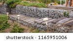 gabion is a wire cage filled... | Shutterstock . vector #1165951006
