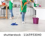 Woman Cleaning Floor With Mop...