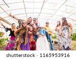 female people dancing together... | Shutterstock . vector #1165953916