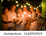 group of people celebrate an... | Shutterstock . vector #1165953919