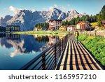 tourist walking on the pier on...   Shutterstock . vector #1165957210