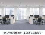 company office corner with a... | Shutterstock . vector #1165963099