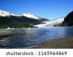 glaciers and snow covered... | Shutterstock . vector #1165964869