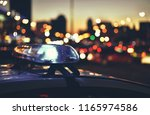 flashers of police car on...   Shutterstock . vector #1165974586