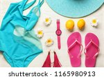 composition with beach items on ... | Shutterstock . vector #1165980913