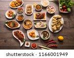 indonesian famous food   padang ... | Shutterstock . vector #1166001949