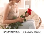Woman With Beautiful Red Roses...
