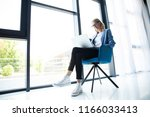 hipster woman use laptop huge... | Shutterstock . vector #1166033413