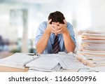 frustrated office manager... | Shutterstock . vector #1166050996