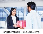 indian businessman giving gift... | Shutterstock . vector #1166063296