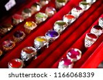 sapphire ring on red box | Shutterstock . vector #1166068339