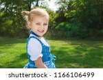 little girl in traditional... | Shutterstock . vector #1166106499