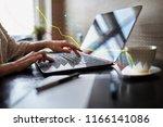 graphs on virtual screen.... | Shutterstock . vector #1166141086