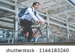 healthy business man riding his ... | Shutterstock . vector #1166183260