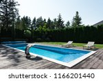 view of poolside with sunbeds... | Shutterstock . vector #1166201440