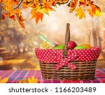 wooden table with autumn leaves ... | Shutterstock . vector #1166203489