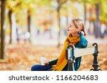 happy young girl in yellow... | Shutterstock . vector #1166204683