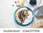breakfast  oatmeal with... | Shutterstock . vector #1166237356