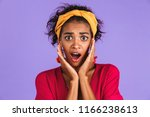 portrait of a shocked young... | Shutterstock . vector #1166238613