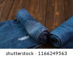 roll frayed jeans or blue jeans ... | Shutterstock . vector #1166249563